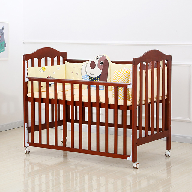 Adjustable Maroon baby wood crib with wheels