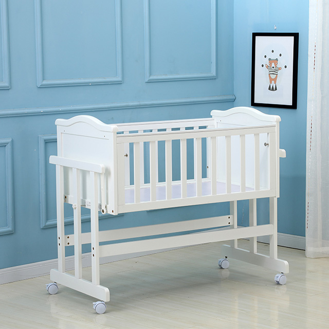 European style white baby crib solid wood with wheels