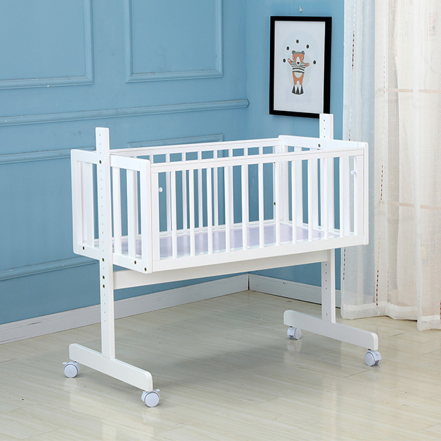 White Solid Wood baby cradle bed with wheels